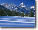 Stock photo. Caption: Grand Teton & Teton Range from Snake River Valley Grand Teton National Park Rocky Mountains, Wyoming -- united states mountain rockies winter snow peak frozen freezing snowy wintery lake mountains cold parks peaks ranges america landscape landscapes blue skies sunny clear scenic scene views view crisp clean