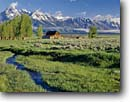 Stock photo. Caption: Old barn at Antelope Flats Teton Range Grand Teton National Park Rocky Mountains, Wyoming -- tourist destination destinations attraction attractions historic historical buildings building landscape landscapes parks parks barns tetons rockies classic iconic landmarks landmarks summer ranching ranch ranchland inholdings