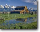 Stock photo. Caption: John Moulton Barn and Grand Teton Snake River Valley Grand Teton National Park Rocky Mountains, Wyoming -- tourist destination destinations attraction attractions historic historical buildings building landscape landscapes parks barns tetons rockies classic iconic landmarks landmarks summer ranching ranch ranchland inholdings snow covered peaks mountain