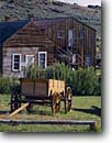 Stock photo. Caption: Covered wagon South Pass City   State Historical Site Wyoming -- rockies  history wagon wheels wagons buggies buggy rustic preserved ghost towns town building buildings historic rural country isolated pioneer pioneers bygone days landscape landscapes