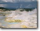 Stock photo. Caption: Porcelain Basin Norris Geyser Basin Yellowstone National Park Rocky Mountains, Wyoming -- american summer vacation travel tourist destination destinations sunsets world heritage site sites geysers basins parks steam steamy summer hotsprings geothermal volcanic activity eruption erupt eruptions rockies feature features stormy clouds cloudy