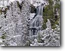 Stock photo. Caption: Undine Falls Gardiner River Yellowstone National Park Rocky Mountains, Wyoming -- world heritage site sites travel destination destinations landscape landscapes rockies scenic scenics family vacation mountain trees freezing frozen cold snow snowy rivers forests waterfall waterfalls landmarks landmark parks covered tree attractions