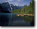 Stock photo. Caption: Moraine Lake & Wenkchemna Peaks Banff National Park Rocky Mountains Alberta,  Canada -- blue glacial lakes world heritage site parks canadian rockies landscape landscapes tourist travel holiday destination destinations peak distance expanse expansive calm tranquil dock docks canoe canoes boat boats vacation attraction attractions clear water