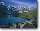 Stock photo. Caption: Moraine Lake and Wenkchemna Peaks Banff National Park Rocky Mountains Alberta,  Canada -- blue glacial lakes world heritage site parks canadian rockies landscape landscapes tourist travel holiday destination destinations peak distance expanse expansive calm tranquil ethereal pristine solitude peace peaceful sunny clear classic view views icon