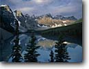 Stock photo. Caption: Moraine Lake and Wenkchemna Peaks Banff National Park Rocky Mountains Alberta,  Canada -- blue glacial lakes world heritage site parks canadian rockies landscape landscapes tourist travel holiday destination destinations peak colour aqua expansive calm tranquil ethereal pristine solitude peace peaceful sites reflection reflections classic view