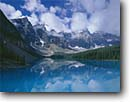 Stock photo. Caption: Moraine Lake and Wenkchemna Peaks Banff National Park Rocky Mountains Alberta,  Canada -- blue glacial lakes world heritage site parks canadian rockies landscape landscapes tourist travel holiday destination destinations colour aqua expansive calm tranquil ethereal pristine solitude sites summer glacially carved valleys reflection reflections