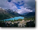 Stock photo. Caption: Peyto Lake and Mt. Patterson Banff  National Park Rocky Mountains Alberta,  Canada -- aqua blue glacial silt fall autumn tree trees lakes world heritage site parks mountain canadian rockies landscape landscapes tourist destination destinations peak peaks azure attractions cloudy grand vista view views scenic scenics majestic alpine wild