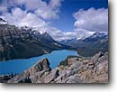 Stock photo. Caption: Peyto Lake,  Mt. Patterson and Mt. Weed Banff National Park Rocky Mountains Alberta, Canada -- blue glacial lakes world heritage site parks mountain canadian rockies landscape landscapes tourist travel holiday destination destinations peak peaks distance expanse expansive calm tranquil solitude majestic peace peaceful glaciers snow capped clean