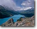 Stock photo. Caption: Peyto Lake,  Mt. Patterson & Mt. Weed Banff  National Park Rocky Mountains Alberta,  Canada -- aqua blue glacial silt fall autumn tree trees lakes world heritage site parks mountain canadian rockies landscape landscapes tourist destination destinations peak peaks hiker people stormy breaking storm hikers scenic scenics woman women vista vistas