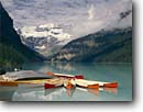Stock photo. Caption: Boat dock on Lake Louise Banff National Park Rocky Mountains Alberta, Canada -- landscape landscapes scenics scenic lakes landmark landmarks parks mountain glaciers glacial silt turquoise color colour classic view views vista vistas international summer boats canoes canoe docks rental overcast activity outdoor recreation