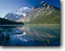 Stock photo. Caption: Cavell Lake and Mt. Edith Cavell Jasper National Park Rocky Mountains Alberta, Canada -- landscape landscapes scenics scenic lakes parks mountain glaciers glacial silt turquoise color colour classic view views vista vistas summer peaks peak canadian attraction attractions clear sunny blue destination destinations reflection reflections calm