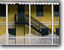 Stock photo. Caption: Old Danish Customs House Christiansted National Historic Site Christiansted, St. Croix U.S. Virgin Islands -- forts sites island tropical destination destinations caribbean historical tourist attraction attractions site sites resistance protection buildings local charm charming yellow fence saint united states charming elegant building artistic design balance