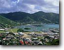 Stock photo. Caption: Road Town and Road Bay    from Joes Hill Road Tortola British Virgin Islands -- caribbean towns city cities harbor harbors harbour harbours boat boats clouds tropical destination destinations vacation vacations tourist travel island sunny warm exotic quaint colonial building buildings famous places place cruise ship landscapes scenic