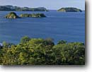 Stock photo. Caption: Chocoyas and Plata Islands and  Salinas Point   from Prieta Beach Protero Bay Guanacaste Province,  Costa Rica -- point provinces beaches pacific coast shore ocean central america tropical destination destinations vacation vacations tourist travel headland headlands warm sunny exotic ecotourism ecotourist latin american azure blue clear island