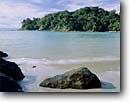 Stock photo. Caption: Catedral Point   from  Manuel Antonio Beach Manuel Antonio National Park Puntarenas Province,  Costa Rica -- beach beaches pacific ocean tropical destination destinations travel tourist seastack seastacks points warm sunny ecotourist ecotourism latin protected parks landscape landscapes latin central american scenics scenic views tropics america sandy secluded