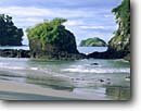 Stock photo. Caption: Catedral Point and Olocuita Island   from South Espadilla Beach Manuel Antonio National Park Puntarenas Province,  Costa Rica -- beach beaches pacific ocean tropical destination destinations travel tourist seastack seastacks points warm sunny ecotourist ecotourism latin protected parks landscape landscapes latin central american scenics scenic views tropics america sandy secluded