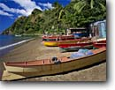 Stock photo. Caption: Local made fishing boats Soufriere Bay Dominica Windward Islands,  Lesser Antilles -- boat detail bright colors caribbean seas tropical destination destinations handmade crafted tourist travel beach beaches fish exotic warm climate ocean wooden livelihood nets sandy azure blue clear skies building buildings landscapes landscape scenic