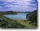 Stock photo. Caption: Oruruhoa Bay and Urupukapuka Island   from Te Tawa Hill, Rawhiti Bay of Islands North Island,  New Zealand -- seas tropical destinations destination vacation vacations tourist travel exotic warm climate ocean harbour harbor harbours harbors bays southern hemisphere landscape landscapes scenic scenics winter seascape seascapes