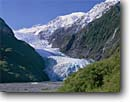 Stock photo. Caption: Franz Josef Glacier Waiho River,  Southern Alps Westland National Park South Island,  New Zealand -- International trip mount vacation peak peaks blue mountains mountain spring landscape beauty travel destination destinations trips vacations snow capped glaciers massive power indestructable moraine geology erosion southern hemisphere landscapes scenic