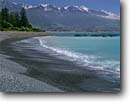 Stock photo. Caption: Seaward Kaikoura Range    from Kaikoura South Pacific Ocean South Island, New Zealand -- mountains rocky shore shoreline shorelines morning summer travel destination destinations tourist ranges seascape seascapes oceans bays  sunny clear peaks peak mountain snow capped blue skies clear waves wave surf sunny landscape landscapes scenic scenics