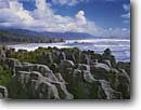 Stock photo. Caption: Pancake Rocks,  Dolomite Point Paparoa National Park Tasman Sea South Island,  New Zealand -- beaches skinner point points headlands surf wave waves parks pacific travel destination destinations tourist seascape seascapes limestone erosion eroded geology geologic formation formations funny looking patterns unusual landmarks landmark named scenic