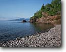 Stock photo. Caption: Theono Point   south of Montreal River Harbor Lake Superior Ontario,  Canada -- canadian lakeshore lakeshores rocky shore shoreline bays lakes parks north america summer great harbour harbours forest forests beaches beach region shorelines shores blue sky skies clear sunny forest forests trees tree covered secluded rocks