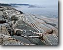 Stock photo. Caption: Migmatite,  Oiseau Bay Pukaskwa National Park Lake Superior Ontario,  Canada -- glacial polished shield canadian lakeshore lakeshores rocky shore shoreline bays lakes parks north america summer great metamorphic metamorphized rock gneiss landscape landscapes rock rocks unusual striped geology geologic formation formations sunny clear