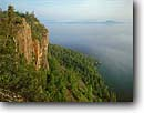 Stock photo. Caption: Top of the World Spar Island Lake Superior Ontario,  Canada -- canadian lakeshore lakeshores  shore shoreline lakes north america summer great distances distance view vista vistas cliffs islands landmark landmarks forest forests shorelines clear sunny soaring height heights region great lakes landscape landscapes