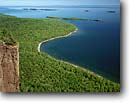 Stock photo. Caption: Tee Harbor Sleeping Giant Provincial Park Lake Superior Ontario,  Canada -- canadian lakeshore lakeshores  shore shoreline bays lakes parks north america summer great vast harbour harbours landscape landscapes cliffs tree trees forest forests calm clear sunny blue sky skies landmark landmarks blue water shorelines
