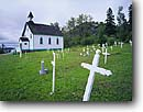 Stock photo. Caption: St. Sylvester R. C. Church Shore of Lake Helen   near Nipigon Ontario, Canada -- churches cross crosses graves gravesite gravesites historic historical canadian religious religion summer country rural cemetery cemeteries place worship christian christianity burial ground grounds grave site sites building buildings holy dead burying