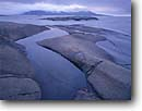 Stock photo. Caption: Foster and Pic Islands in Lake Superior   near Neys Provincial Park Ten miles west of Marathon Ontario,  Canada -- canadian lakeshore lakeshores rocky shore shoreline lakes north america summer glacial polished shield glaciers  landscape landscapes  distance rock rocks smooth islands artistic nature scenic scene overcast light soft