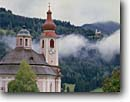 Stock photo. Caption: St. Jakeb Church,  Strassen and St.   Oswald Church,  Kartitsch-Boden Highway 100,  Drau River Valley East Tirol,   Austria -- mountains fall autumn austrian  churches colors rural pastoral europe european clock clocks religion religious icons icon clocktower tyrol landscape landscapes towers steeple steeples history historical building buildings historic cloudy scenics scenic