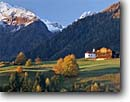 Stock photo. Caption: Karnische Alps  from near Lesach Drau River Valley East Tirol, Austria -- gelback mountains snow capped fall autumn austrian pasture pastures church churches color colors peaks peak rural pastoral europe european landscape landscapes tyrol scenic scenics sunny clear blue serene patience mountain eternal time secure skies