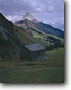 Stock photo. Caption: Dairyman hut   near Warth and Biberkopf Allgauer Alps Voralberg Alps,  Austria -- world farmer snow peak peaks fall autumn europe european travel vacations trips tourist destination destinations attraction attractions landscape landscapes quaint village rural idyllic rustic pastoral austrian scenic scenics cloudy clouds buildings