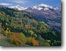 Stock photo. Caption: Le Chatelard,  Pointe Archeboc and   Pointe Foglietta from Highway 26 Rhone-Alps Region French Alps,  France -- mountains fall autumn colors rural pastoral europe european tree trees color peak peaks snow capped rural landscape landscapes countryside sunny clear scenics scenic snow capped peaks peak foliage distance buildings building