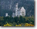 Stock photo. Caption: Neuschwanstein Castle Schwangau Bavarian Alps Bavaria, Germany -- world castles clouds stormy fall autumn color mountains trees europe european vacation travel power tourist destination destinations achievement holiday attraction attractions landscape landscapes security opulence opulent german ludwigs disney inspired