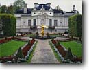 Stock photo. Caption: Linderhof Castle Naturschutzgebiet Bavarian Alps Bavaria,  Germany -- world castles clouds fall autumn europe european vacation travel  wealth power tourist destination destinations achievement attraction attractions security garden gardens statue statues elegant aristocracy aristocrat royal ludwig king formal buildings