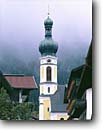 Stock photo. Caption: Church in Reit im Winkle Highway 305 Bavarian Alps Bavaria, Germany -- world river churches rivers foot bridge bridges mountains peak peaks fall autumn europe european travel international famous tourist destination destinations pastoral village villages buildings landscape landscapes attractions landmarks attraction scenics