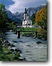 Stock photo. Caption: Church in Ramsau Schottmalhorn in Reiter Alps Bavarian Alps Bavaria, Germany -- world river churches rivers foot bridge bridges mountains peak peaks fall autumn europe european travel international famous tourist destination destinations pastoral village villages buildings landscape landscapes attractions landmarks attraction scenics