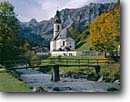 Stock photo. Caption: Church in Ramsau and Schottmalhorn     in the Reiter Alps Bavarian Alps Bavaria, Germany -- world river churches rivers foot bridge bridges mountains peak peaks fall autumn europe european travel international famous tourist destination destinations pastoral village villages buildings landscape landscapes attractions landmarks attraction scenics