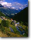 Stock photo. Caption: Varda, Cordevale River Valley and Mt. Pelmo, Highway 244 The Dolomites Venito Region, Italy -- europe european international italian countryside travels roads vacation road highway switchback curve curvy windy mount mountain town village afternoon fall houses clouds hill hillside landscape landscapes world travel carefree twisty buildings building