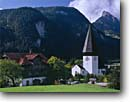 Stock photo. Caption: Town church Saanen and le Rubi The Alps Bern Canton,  Switzerland -- churches worship international travel travels history europe european afternoon fall autumn october towns village sacred holy swiss holy places town towns villages steeple steeples sunny clear blue cross crosses buildings building landscapes landscape
