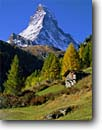 Stock photo. Caption: Old hut and The Matterhorn from Zermatt Valais Canton Valias Alps, Switzerland -- snow peak peaks fall autumn europe european travel tourist destination destinations landmarks landmark landscape landscapes quaint village rural famous climbing heidi sound music idyllic rustic pastoral swiss sunny classic view views building countryside