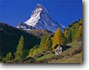 Stock photo. Caption: Old hut and the Matterhorn   from Zermatt Valais Canton The Valais Alps,  Switzerland -- snow peak peaks fall autumn europe european travel tourist destination destinations landmarks landmark landscape landscapes quaint village rural famous climbing heidi sound music idyllic rustic pastoral swiss sunny classic view views building countryside