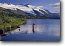 Stock photo. Caption: Fly fishing on Upper Paradise Lake Kenai Mountains Chugach National Forest Alaska -- united states america fishing fisherman summer mountain outdoor recreation trout lakes fishermen cast casting wild catch and release dramatic flyfish flyfishing wilderness wildernesses backcountry glacier glaciers people angler anglers angling