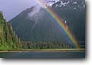 Stock photo. Caption: Rainbow over Red Bluff Bay   Off Chatham Strait Baranof Island, Tongass National Forest Southeast Alaska -- mountains united states america solitude remote wilderness wildernesses outdoor recreation seascape seascapes inlets alaskan inlet bays southeastern rainbows rain rainy summer forests temperate climate rainforests weather