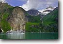 Stock photo. Caption: Small cruise ship in Tracy Arm Coast Mountains Tracy Arm-Fords Terror Wilderness Tongass National Forest,  Alaska -- alaskan  boating icebergs outdoor adventure forests glacial glaciers floating wildernesses inside passage southeast southeastern tourist destination destinations travel ships ecotour boats fiord travel tourist vavtion destination destinations attraction a