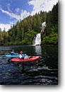 Stock photo. Caption: Waterfall in Red Bluff Bay off Chatham Strait, Baranof Island  Tongass National Forest Southeast Alaska -- alaskan kayaking boating outdoor adventure forests floating waterfalls travel tourist vavtion destination destinations attraction attractions   wildernesses inside passage southeast southeastern kayaks paddling paddle people kayak kayaker kayakers