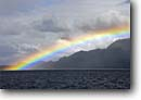 Stock photo. Caption: Summer rainbow Inside Passage Tongass National Forest Southeast Alaska -- alaskan forests destinaiton tourist wildernesses southeastern rainbows weather rain rainy storm storms stormy