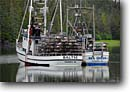 Stock photo. Caption: Crab fishing boats in Berg Bay Eastern Passage Tongass National Forest Southeast Alaska -- alaskan boats outdoor forests floating inside passage southeast southeastern fishing boat fish harvest commerce vessel crabbers cabbing  commercial pot pots